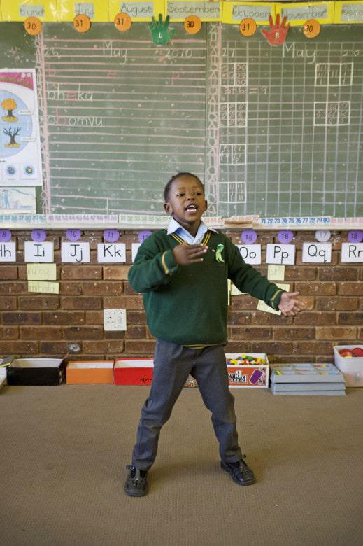 Thandi Chitha, a Grade 1 pupil at the Inkath- Ka-Zulu Primary school in Daveyton performs as she recites a poem.