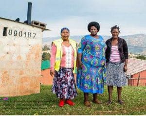 Doris Ntuli (center) stands alongside two of her colleagues after completing house-to-house visit in the community of Sweet Waters.