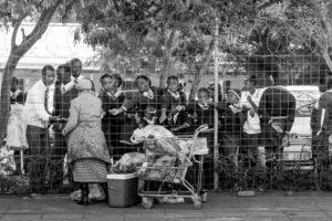 High School Students in Dundee buying snacks through the school fence at break time
