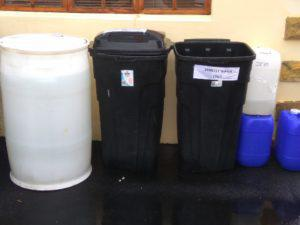 Plastic drums and refuse bins used to store water