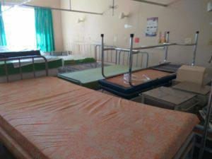 Beds are stacked on top of one another in empty rooms in Nketoane Hospital