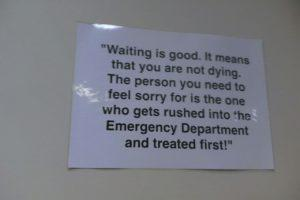 "No sign of improving, a sign flippantly tells patients that their long waiting times means ""they're not dying"""