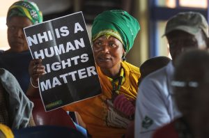 """Posters showing """"This is a human rights matter"""" during NHI Hearings Kagiso"""