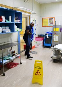 Cleaner mopping floors in the hospital