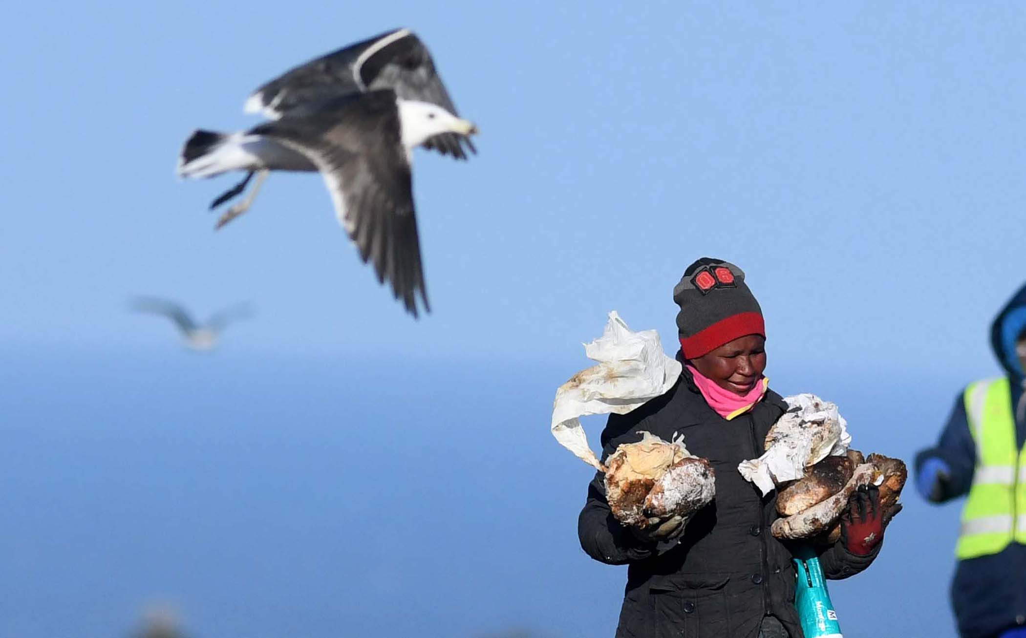 A woman happy for the stale bread she could salvage. PHOTO: Black Star/Spotlight