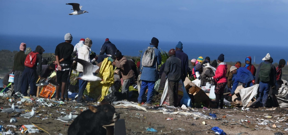 Scavenging at landfill sites often does not allow for social distancing. PHOTO: Black Star/Spotlight