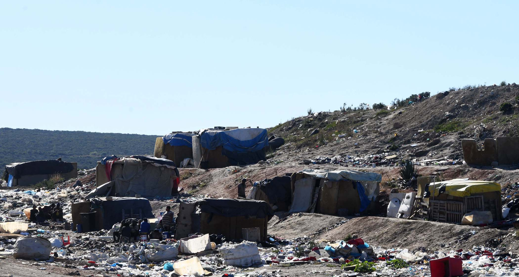 Some waste pickers live in makeshift shacks on the landfill site in Uitenhage.