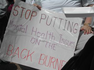 Poster stating 'Stop putting mental health issues on the back burner'. A national survey found over 30% of those living in South Africa have experienced a depressive, anxiety, or substance use disorder in their lifetime. PHOTO: Liz Spikol/Flickr