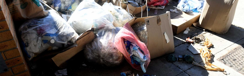 Open red medical waste bags among the general waste piling up at Livingstone Hospital. PHOTO: Black Star/Spotlight