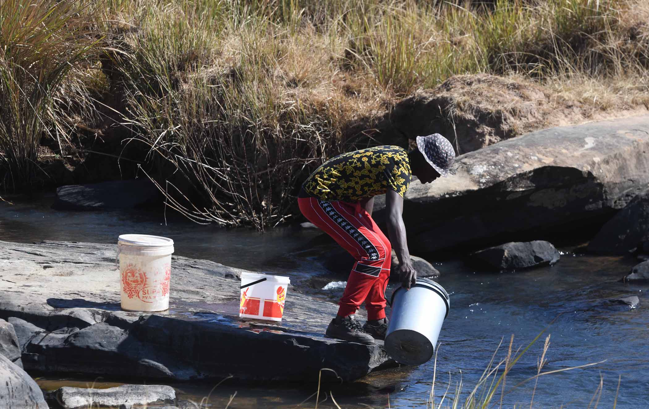 "Many residents in rural communities in the Eastern Cape say water is too scarce to ""waste"" on washing hands. PHOTO: Black Star/Spotlight"