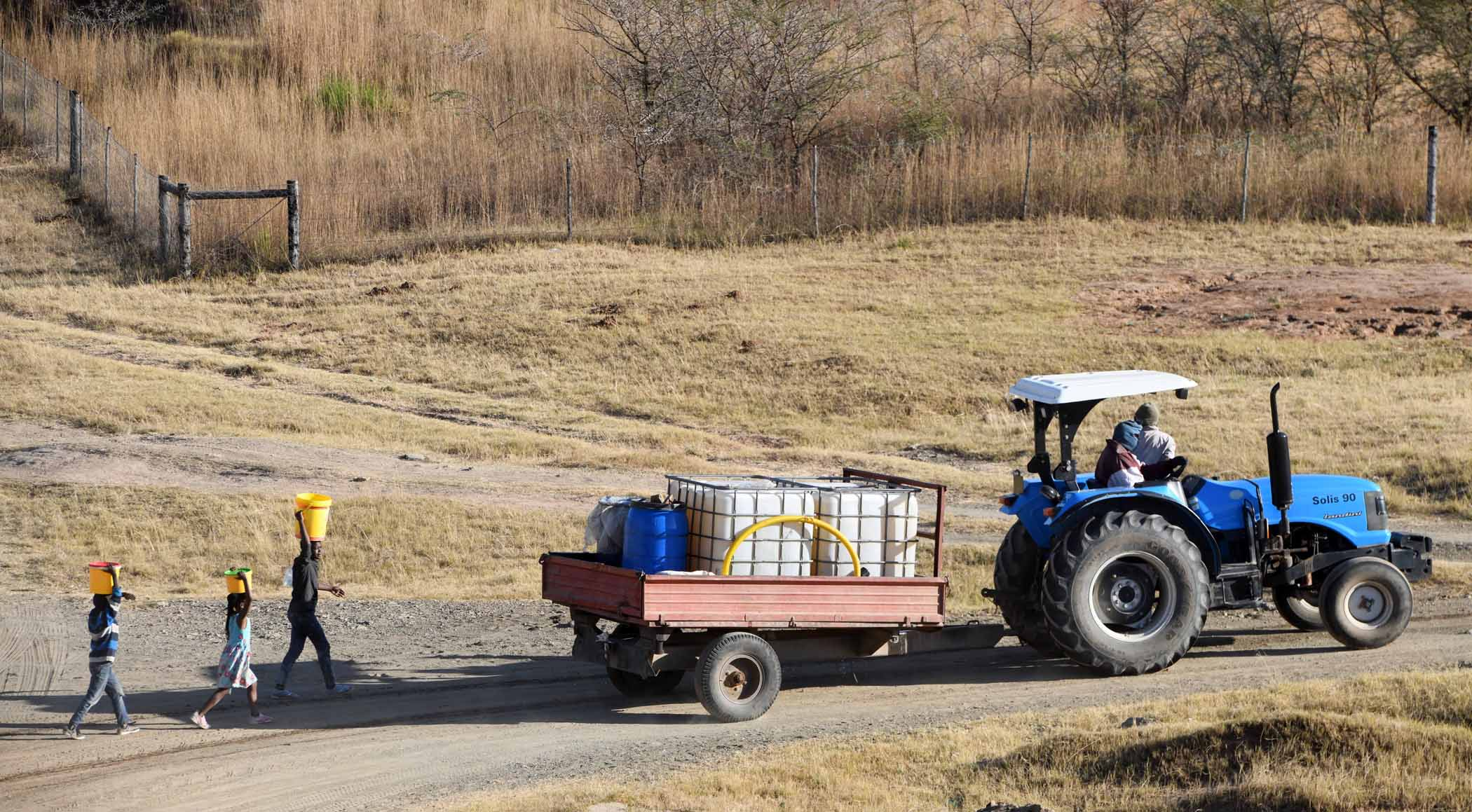 In some communities, residents hire trucks, tractors or bakkies to fetch water. PHOTO: Black Star/Spotlight
