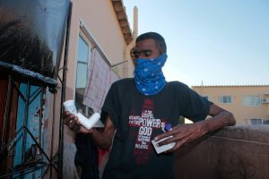 Sagren Govender (47) now depends on a nebuliser tank and inhalers to help with his breathing difficulties. He describes living in this area as a 'nightmare'. PHOTO: Sandile Duma/Spotlight