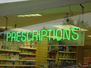 pharmacy with neon prescriptions sign