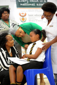 Former Minister of Health Dr Aaron Motsoaledi launched the Human Papilloma Virus Vaccine at Gonyane Primary in Mangaung in 2014. PHOTO: GCIS