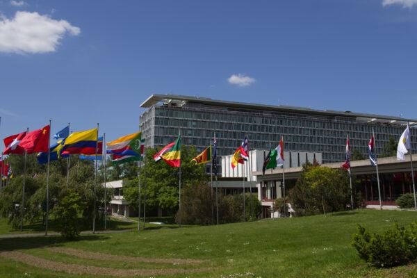 World Health Organization building with flags in Geneva, Switzerland. PHOTO: U.S. Mission Geneva/ Eric Bridiers