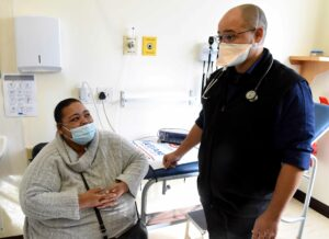 Doctor in long-COVID clinic with patient Kim Japhta