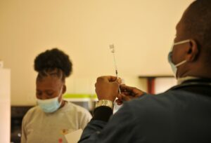 healthcare worker preparing needle for vaccination