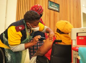A nurse vaccinating a person at Thelle Mogoerane Hospital. Over five million people in the country have received at least one dose of a COVID-19 vaccine. PHOTO: Denvor de Wee/Spotlight
