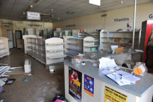 looted pharmacy with empty shelves