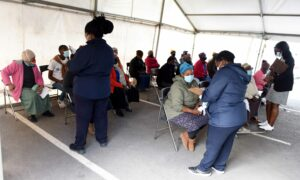 Healthcare workers assisting residents at the Khayelitsha CHC. Nasief Manie/Spotlight.