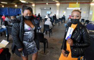 Malawian-born Agness Nyarisa with her sister Margaret Agibu received their jabs at the Athlone Stadium vaccination centre. PHOTO: Nasief Manie/Spotlight